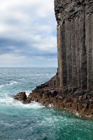 stock photo of bute  - Staffa is an uninhabited island of the Inner Hebrides Scotland known for its geological features - JPG