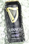 Guinness draught beer in splashed water.