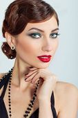 Beautiful young sexy woman with evening makeup and hair, with red lipstick
