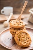 Fork Put On Stacked Cookies And Wood Dish ,focus On Foreground