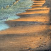 Wavy Sand Under A Bright Sun At Sunset