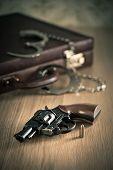 Handcuffs And Revolver