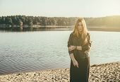 image of gothic hair  - unusual gothic girl with long red hair reflects at the lake - JPG