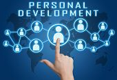 picture of self assessment  - Personal Development concept with hand pressing social icons on blue world map background - JPG