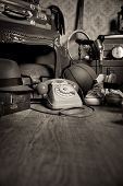 foto of attic  - Group of vintage objects on attic hardwood floor including old toys phone and sports items - JPG