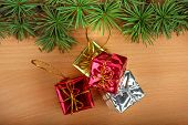 Wonderful Christmas Decoration With Fir Tree And Yellow Silver And Red Gifts Or Presents On Wood