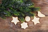 Gingerbread cookies with Christmas decoration on wooden table background