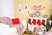 White sofa in decorated living room. Christmas decoration concept