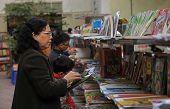 Vietnamese woman buying books
