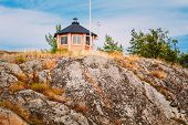 Yellow Finnish Lookout Wooden House On Island In Summer