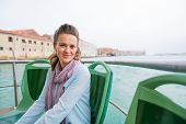 Portrait Of Young Woman Travel By Venice Water Bus