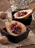 Baked pears with cranberries, honey and walnuts