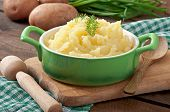 Fresh and flavorful mashed potatoes with wooden table