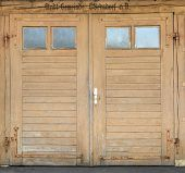 Old light brown garage door with windows