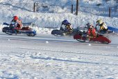 NOVOSIBIRSK, RUSSIA - DECEMBER 20, 2014: Bikers during the semi-final individual rides of Russian Ice Speedway Championship.
