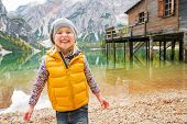 Portrait Of Smiling Child On Lake Braies In South Tyrol, Italy