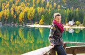 stock photo of south tyrol  - Young woman looking on on lake braies in south tyrol italy - JPG
