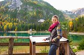 Young Woman Pointing In Information Board While On Lake Braies I