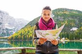picture of south tyrol  - Young woman with map on lake braies in south tyrol italy - JPG