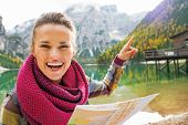 Young Woman With Map On Lake Braies In South Tyrol, Italy Pointi