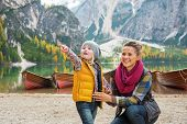 pic of south tyrol  - Mother and baby pointing while on lake braies in south tyrol italy