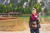 picture of south tyrol  - Portrait of happy young woman on lake braies in south tyrol italy - JPG