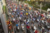 BANGKOK, THAILAND - DEC 5, 2014: Motorcycle traffic jam in city centre during celebrate football fans winning AFF Suzuki Cup 2014. Goals gave them a dramatic 4-3 aggregate victory over Malaysia.