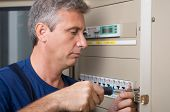 Closeup Of Electrician Repairing Circuit Breaker