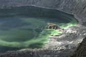 stock photo of vapor  - Vapor and gas vents and green colored water in interior of active barren volcanic crater El Chichonal in Chiapas Mexico on December 19 2014 - JPG
