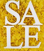 Sale on yellow background