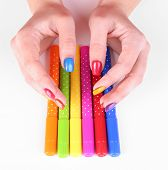 Multicolor female manicure with markers isolated on white
