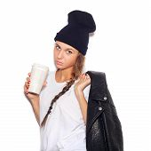 foto of swag  - swag girl in black beanie with cup of coffee looking at camera - JPG