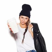 picture of swag  - swag girl in black beanie giving cup of coffee and looking at camera - JPG