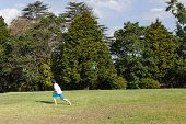 picture of glider  - Young boy playing throwing  model aircraft glider into skies for flight at home - JPG