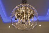pic of chandelier  - Ornate chandelier style ceiling light inside luxury apartment - JPG