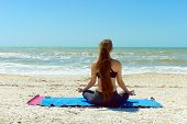 Woman Meditating In Yoga Pose Outdoors