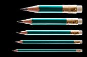 Five pencils on black