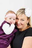 stock photo of new years baby  - mother with her cute little baby girl first year of the new life - JPG
