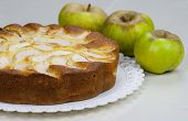 pic of pie-in-face  - Homemade italian baked apple pie over a white table - JPG