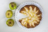 stock photo of pie-in-face  - Homemade italian baked apple pie over a white table - JPG