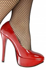 pic of fishnet stockings  - A woman in fishnet stockings with red shoes - JPG