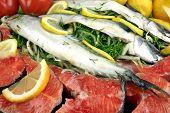 picture of redfish  - Dish With Fresh Stuffed Fish Salmon Steaks Lemon Slice And Herbs - JPG