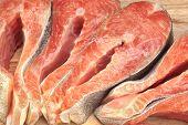 image of lax  - Fresh Raw Salmon Fish Steaks On Wood Cutting Board Close - JPG
