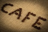 pic of spit-roast  - Roasted coffee beans making the word  - JPG
