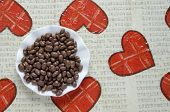 stock photo of decoupage  - Small chocolates balls in a plate on a decoupage table - JPG