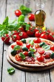 picture of hot fresh pizza  - Italian hot pizza with salami olive and tomato selective focus - JPG