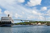 foto of curacao  - Luxury blue and white cruise ship moored beside bridge in Curacao - JPG