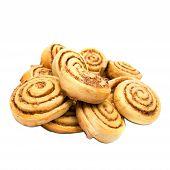 image of cinnamon  - Sweet tasty cinnamon rolls isolated on white background - JPG