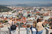 Turists Looking Down On Main City Of Slovenia poster