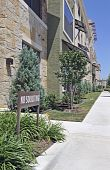 image of soliciting  - No soliciting sign outside modern apartment building - JPG